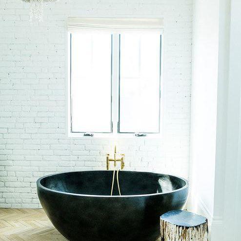 Wood floor, circular tub and chandelier