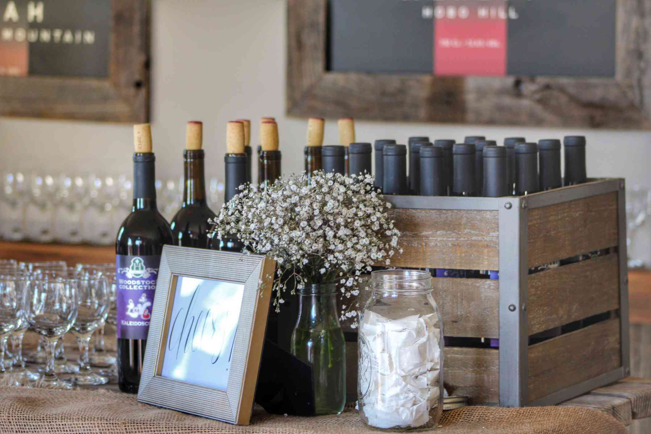 Wine bottles on wooden table and wooden crate