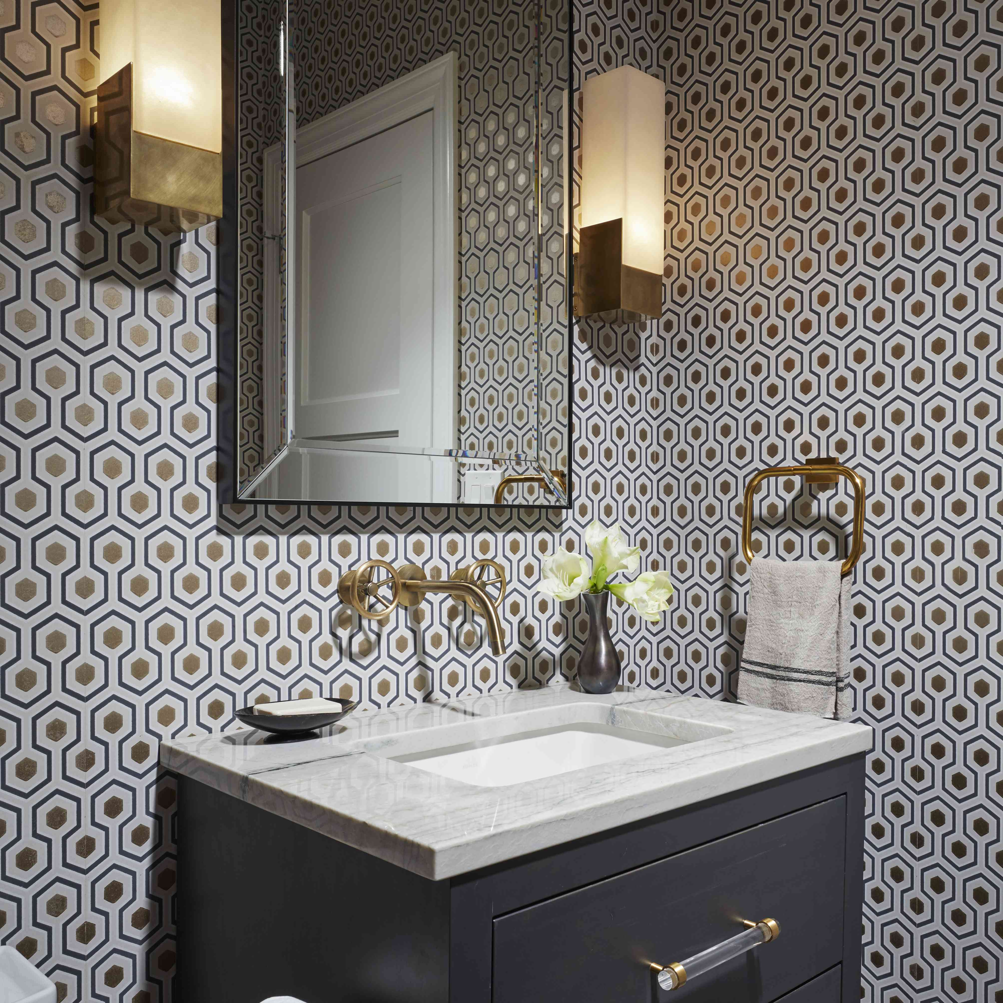 Bathroom with brass and gold fixtures