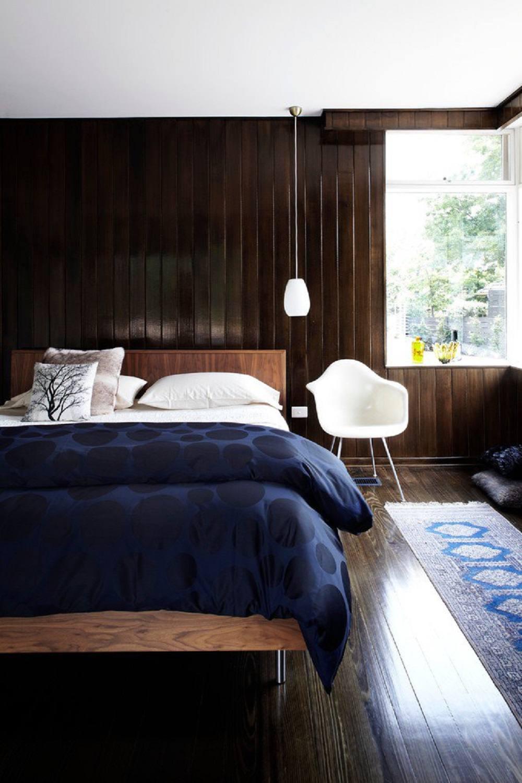 Dark wood walls in modern bedroom