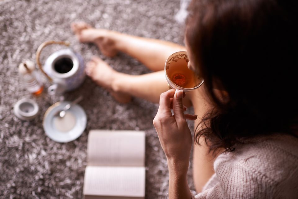 Woman drinking tea in living room