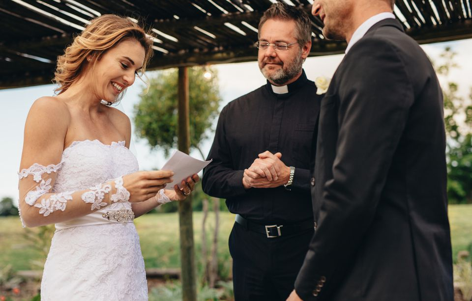 Bride reading during wedding ceremony