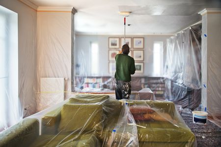 Man Painting A Living Room Ceiling