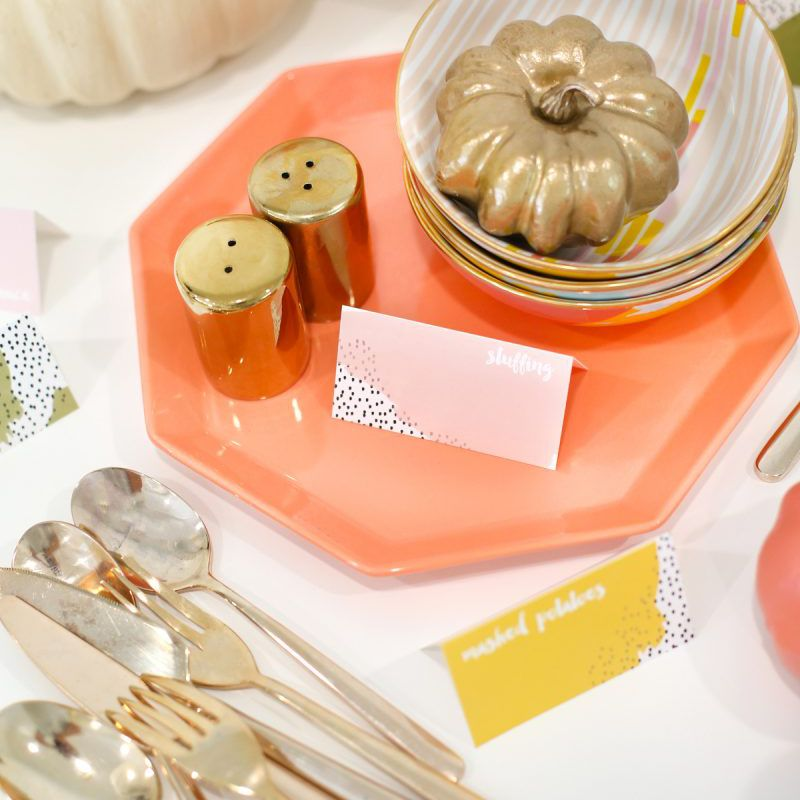 Table with place card and a gold pumpkin