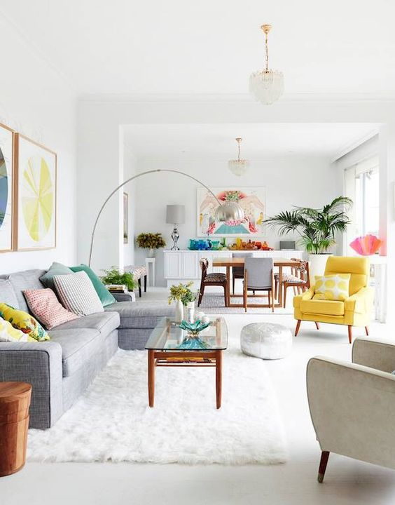 A colorful living room dining room combination.