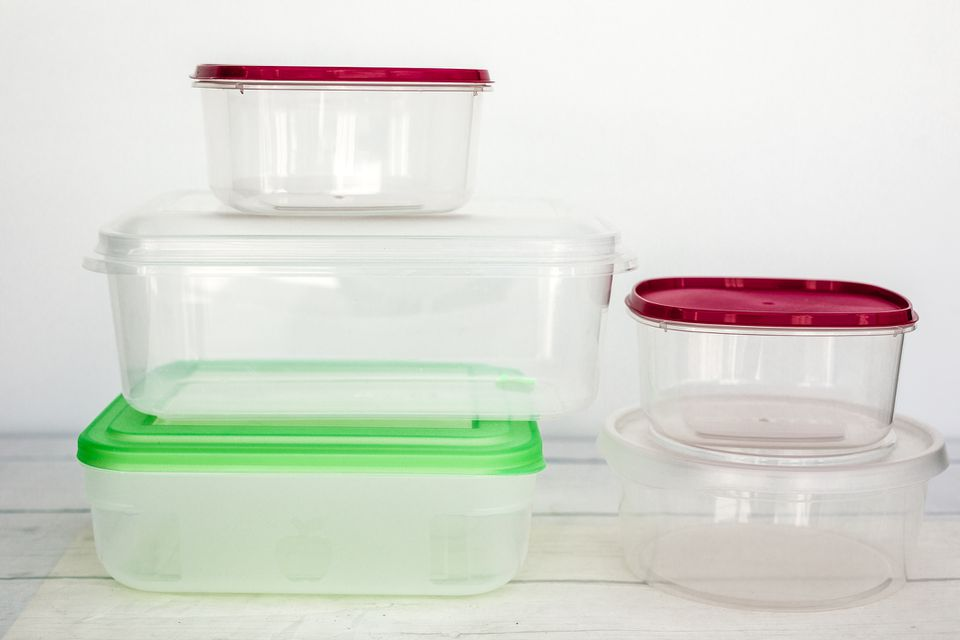 Tupperware of varying sizes stacked next to each other.