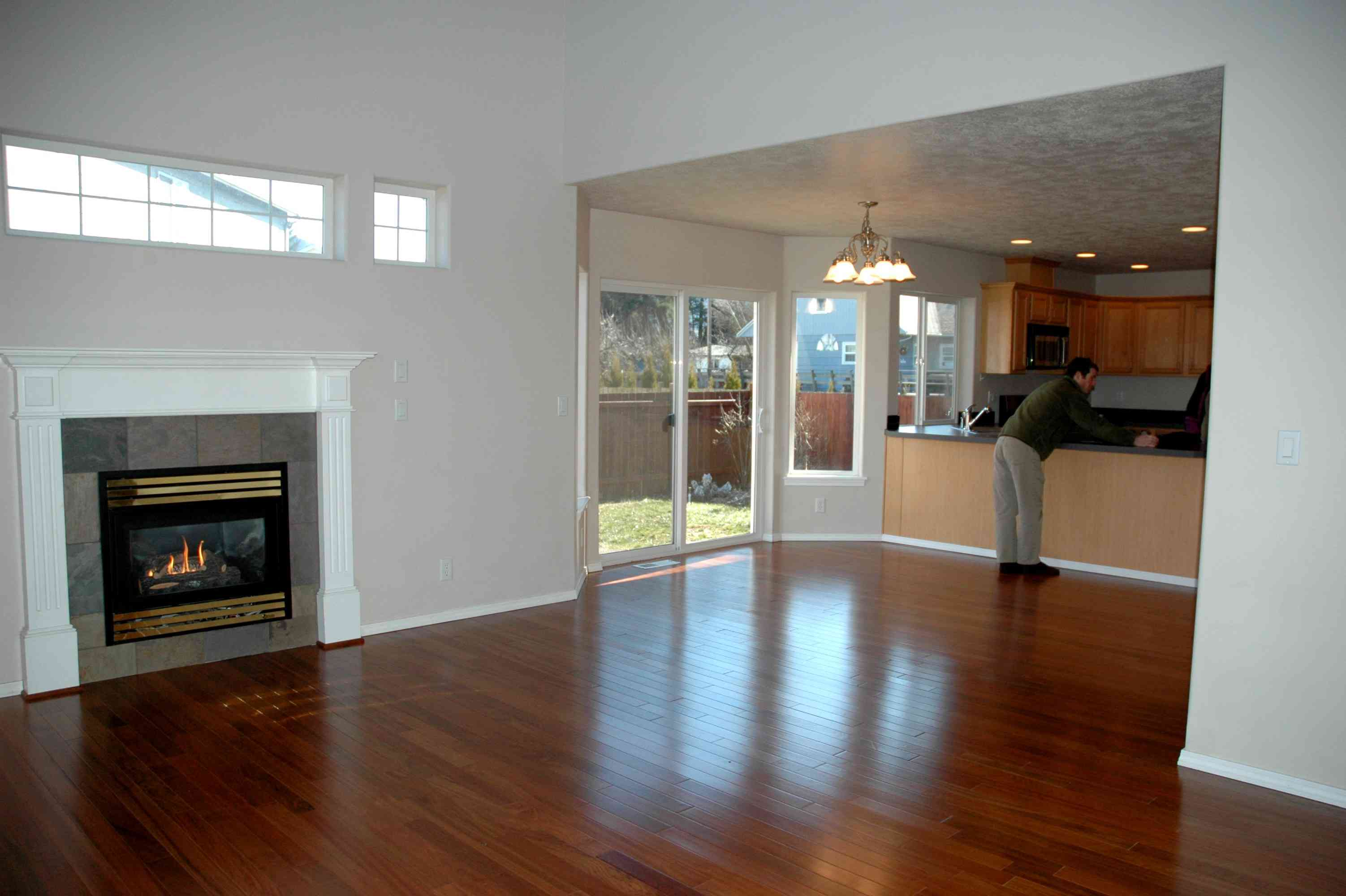Brazilian cherry hardwood floors throughout a living room and dining room