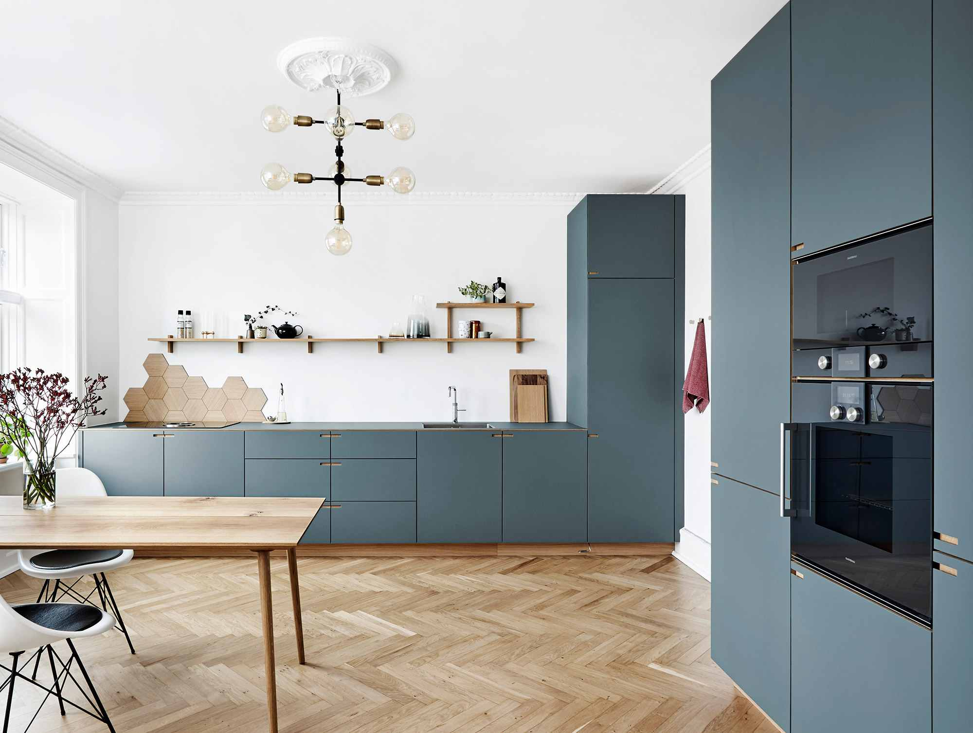 Modern dutch kitchen with slate teal cabinetry and wood floors