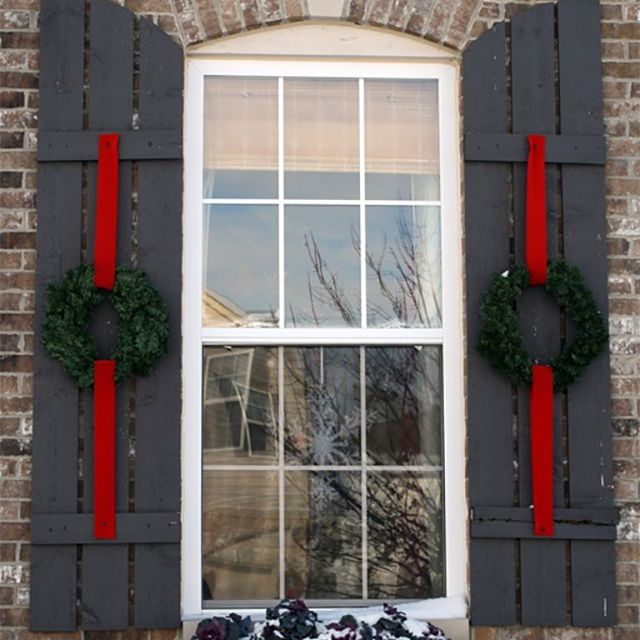 Wreaths and ribbons on house shutters