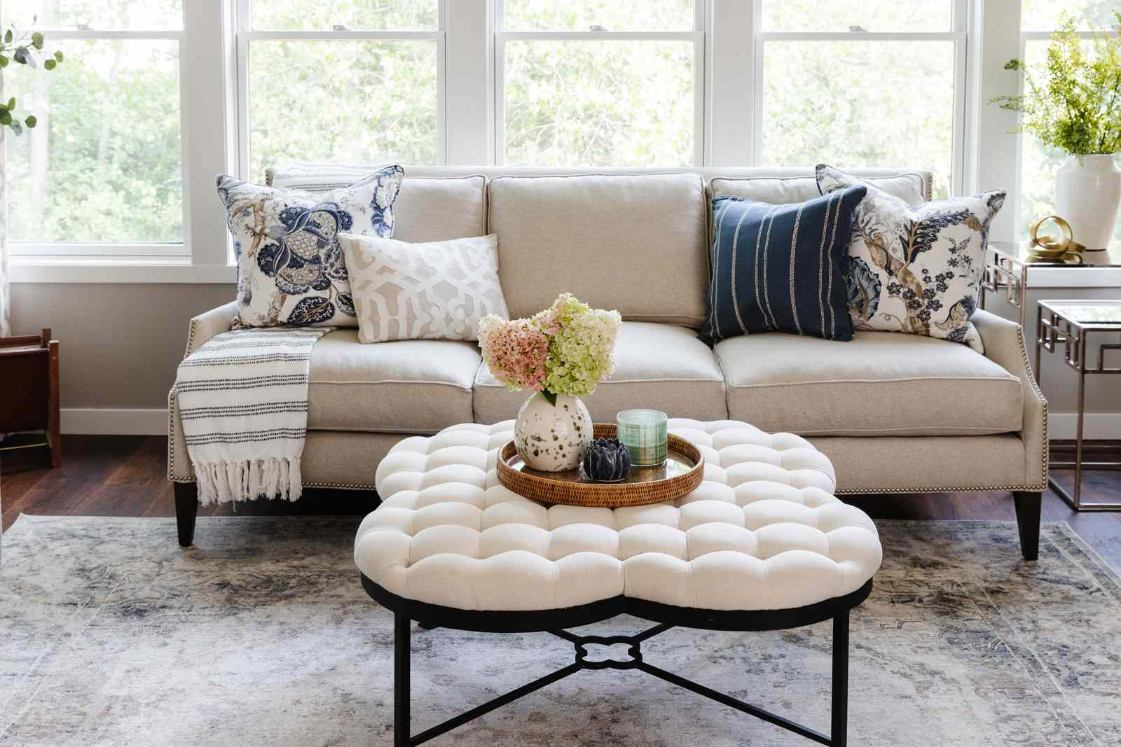 Sofa styled with patterned pillows, a few of which are chintz fabric