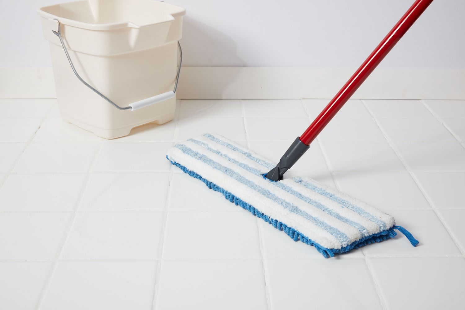 Cleaning tile floor with mop