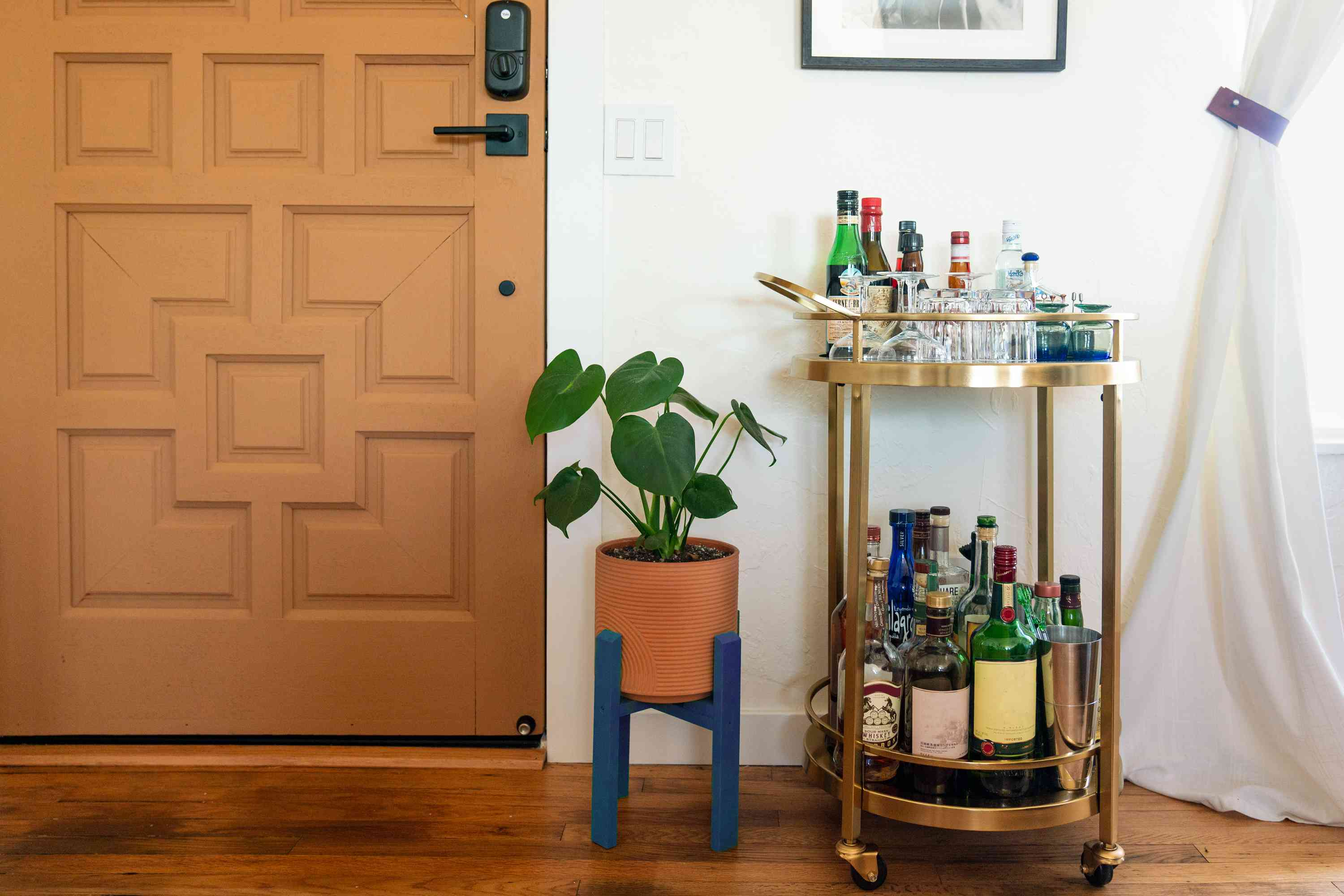 Mid-century modern planter with neutral brown and bold blue next to bar cart