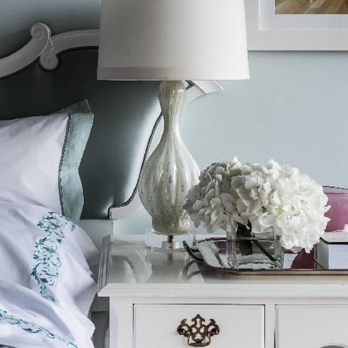 Lacquered white bedside table