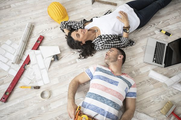 couple surrounded by tools and laptop