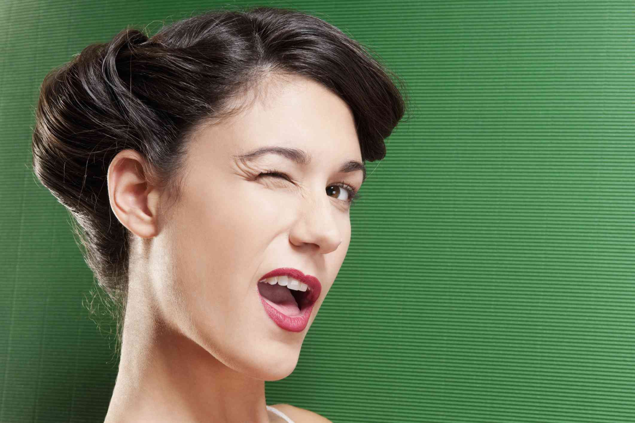 A woman winking