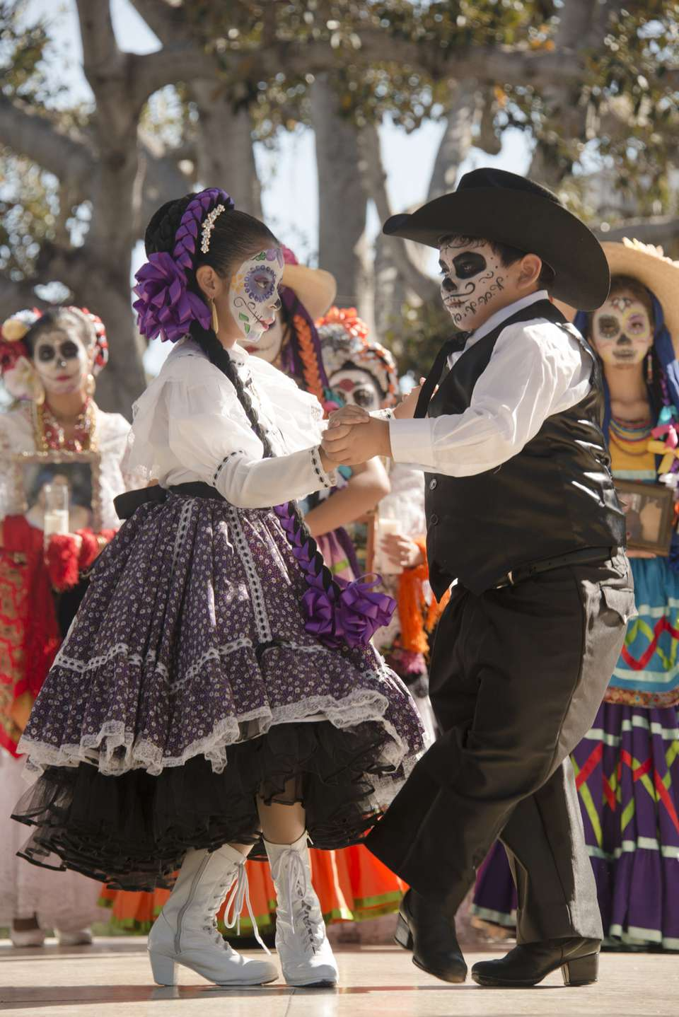 Children dance traditionally at Day of the Dead celebration in Los Angeles