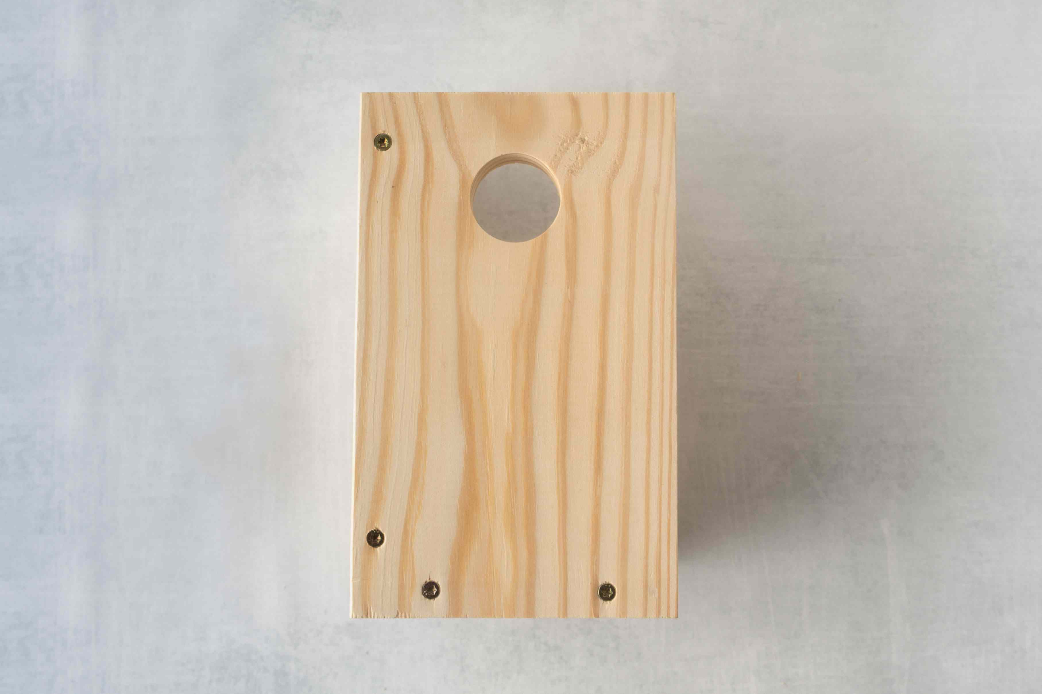A pine board with all hole.