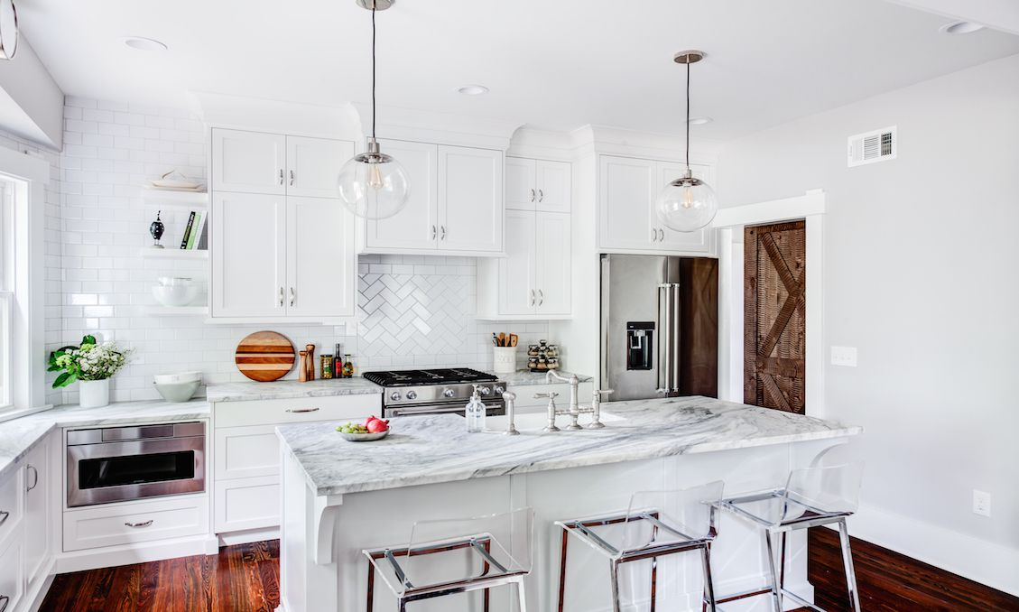 two styles of tile layouts in white kitchen