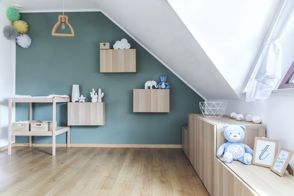 Stylish scandinavian newborn baby room with toys, teddy bear, cotton lamps and star
