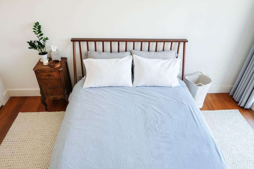a neatly organized small bedroom
