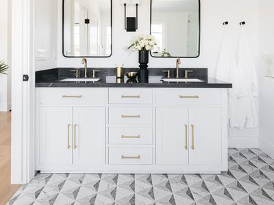 Black and white bathroom flooring with geometric patterns
