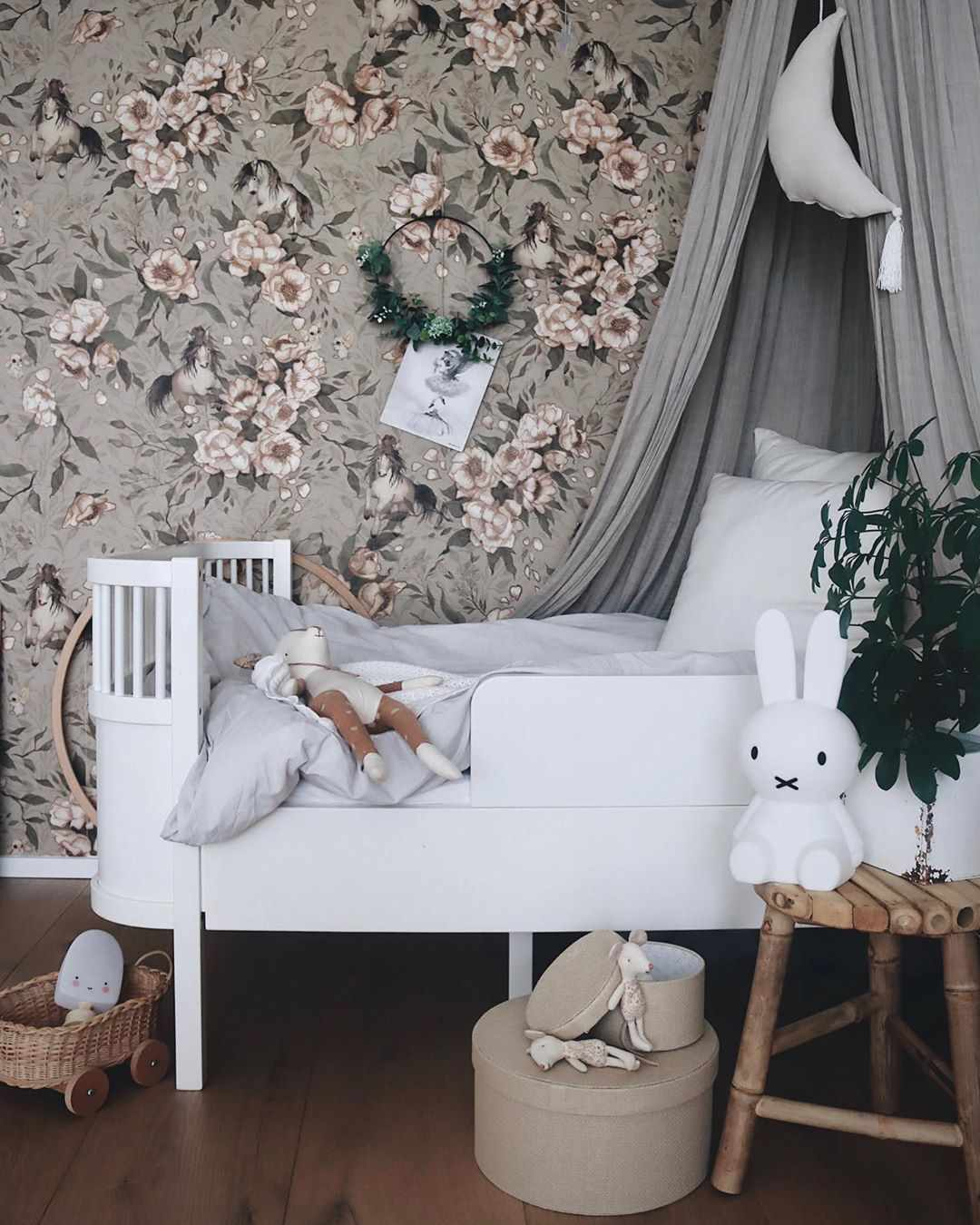 Nursery with floral wallpaper