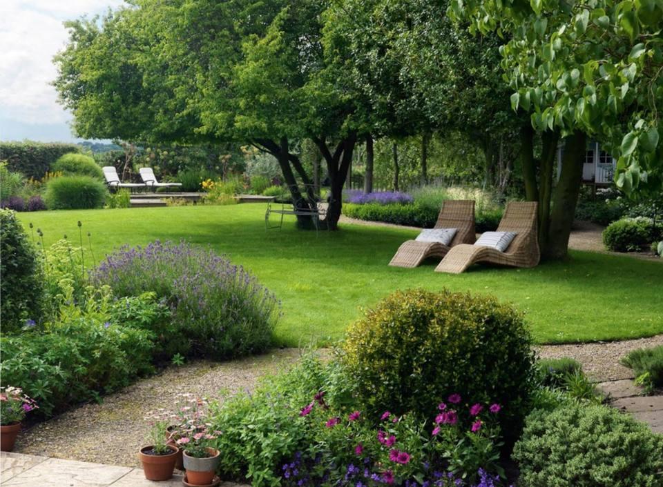 50 Backyard Landscaping Ideas to Inspire You on inspiration for backyard, crafts for backyard, trees for backyard, landscaping for backyard, storage for backyard, art for backyard, garden design ideas, decks for backyard, perennials for backyard, diy for backyard,
