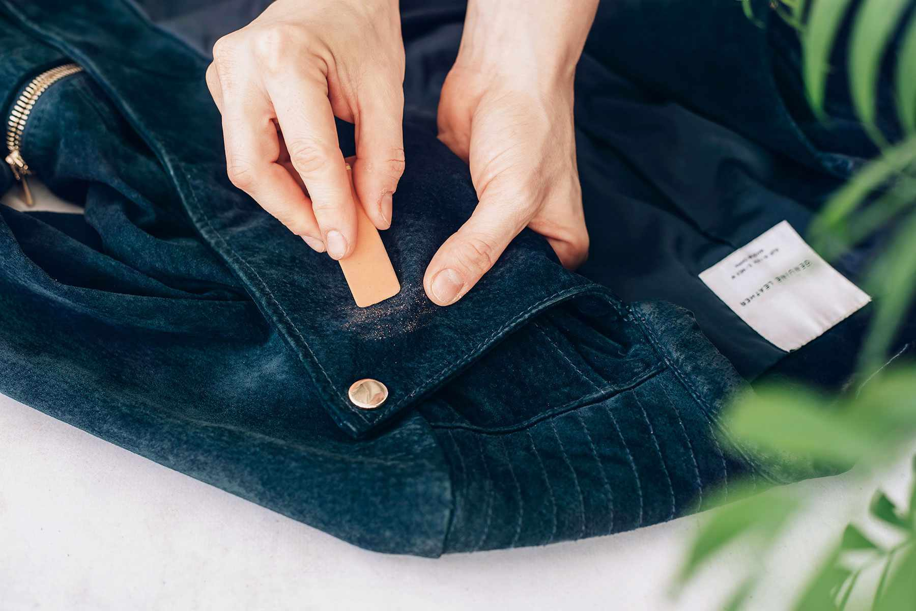 using an eraser on a suede stain