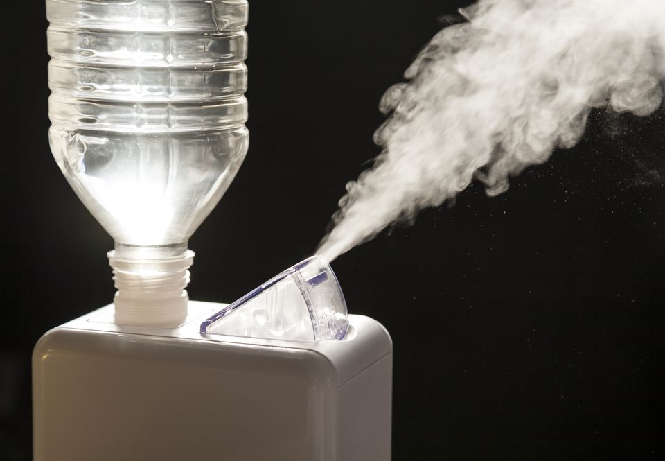 Compact home humidifier creates vapor.