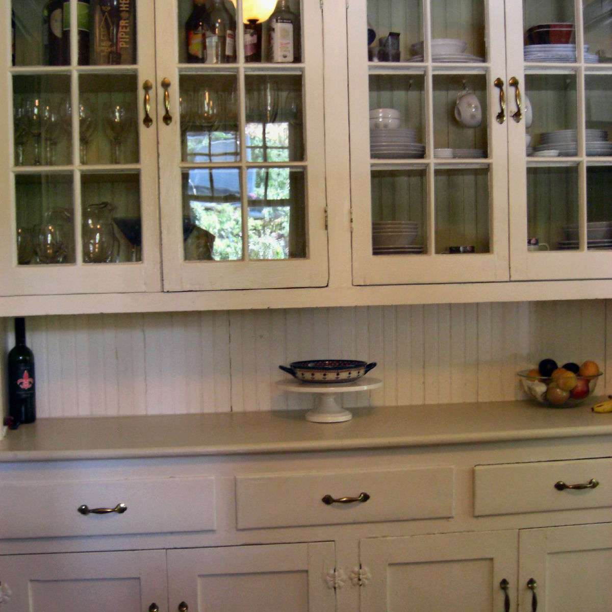 Vintage built-in china cabinet with glass-fronted doors.