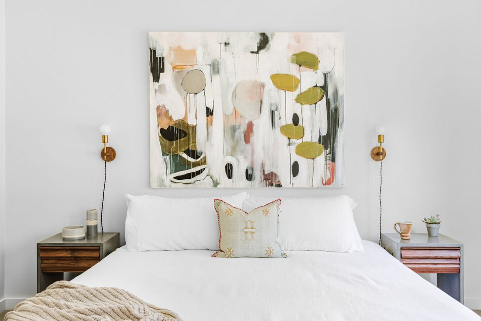 White bedroom with abstract art