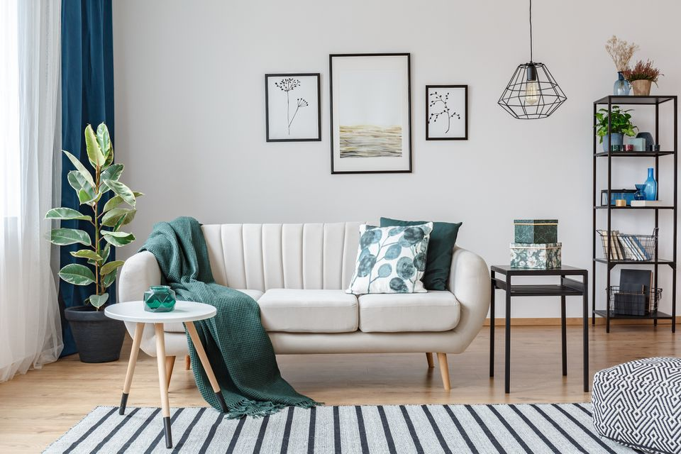 white matte living room with white couch and green accents
