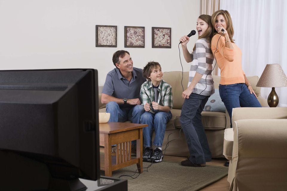 Families Singing karaoke together