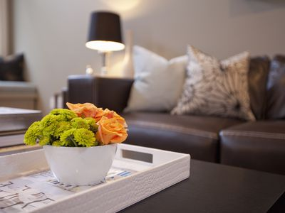 Orange and green flowers in a living room