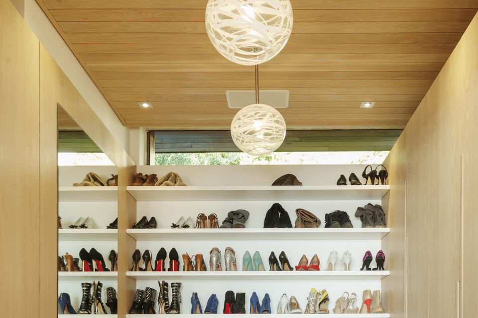Walk-in closet with shoes on shelves