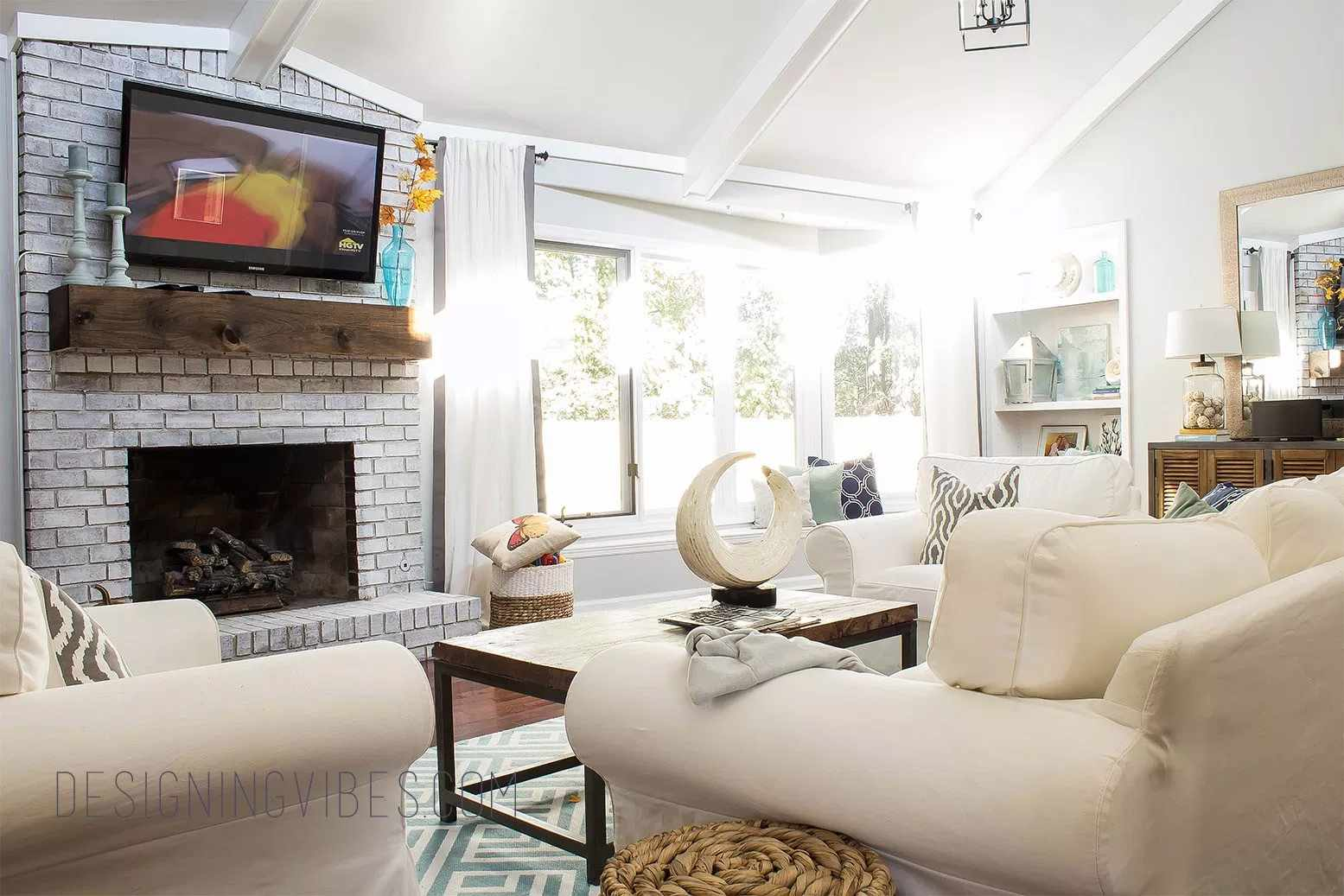 A living room with a fireplace and TV