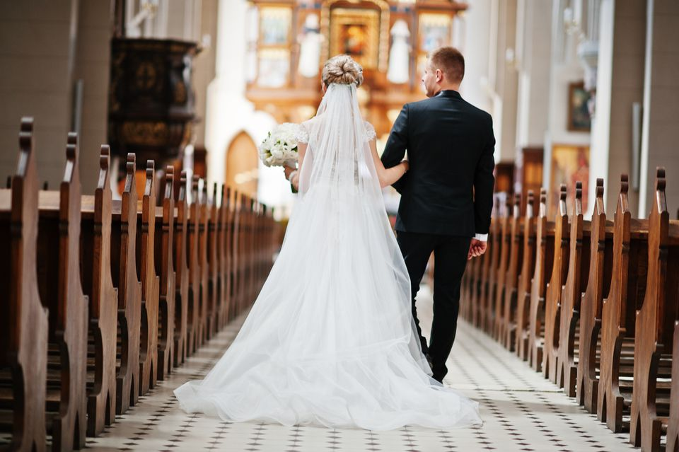 Couple walking down the aisle in a Catholic church