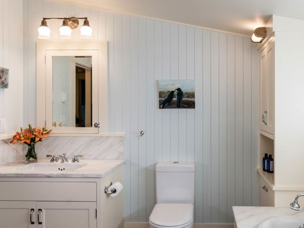 White and blue attic bathroom