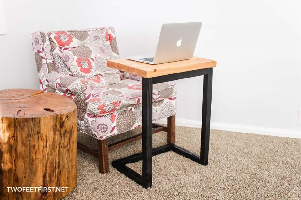 A chair with a laptop stand