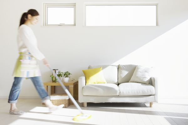 Woman mopping house