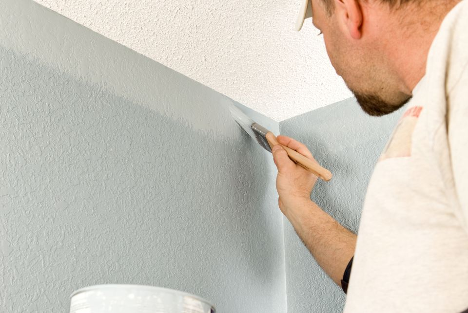 Painter Cutting In Wall