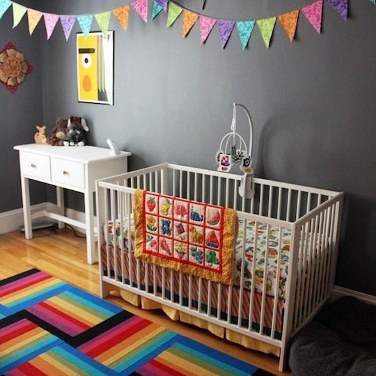 Black and white nursery with colorful, rainbow accents
