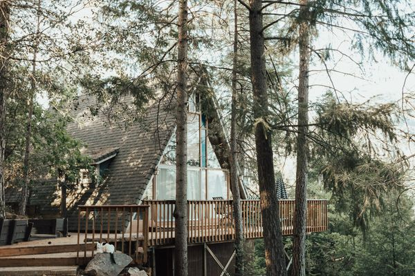 A-frame treehouse with deck
