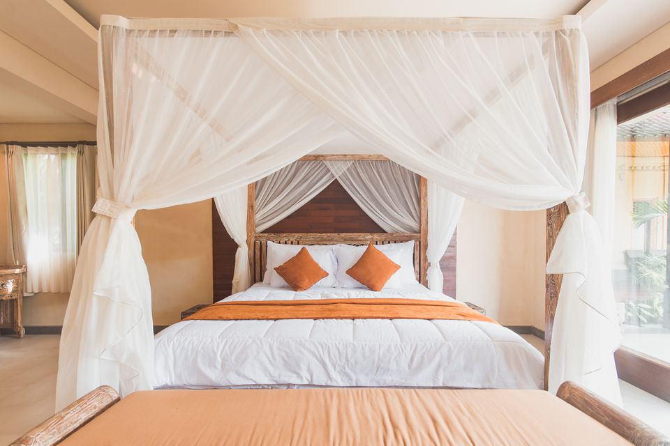 Canopy bed with orange accents