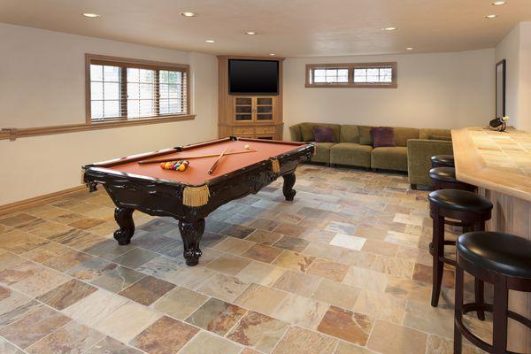 A basement with ceramic tile floors