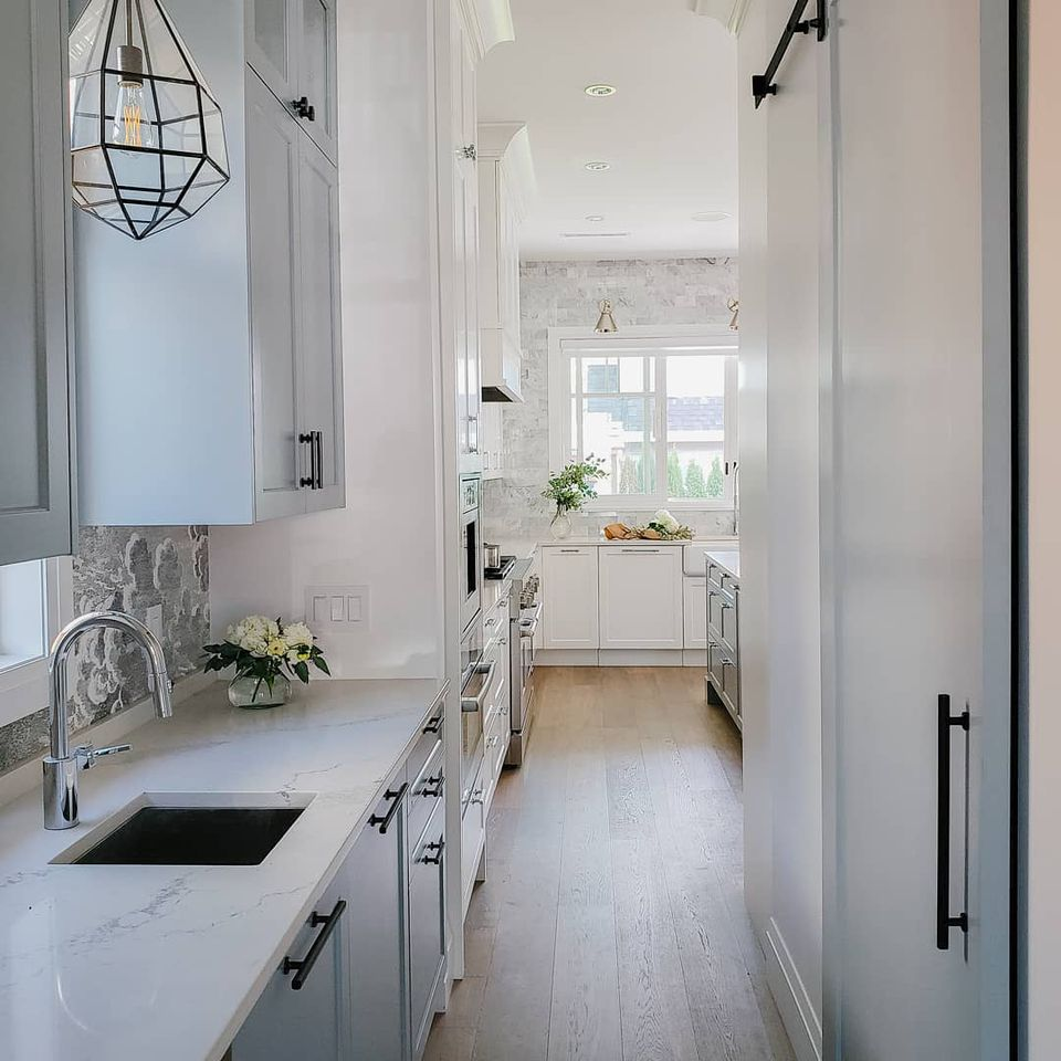 Butler's pantry with marble countertops