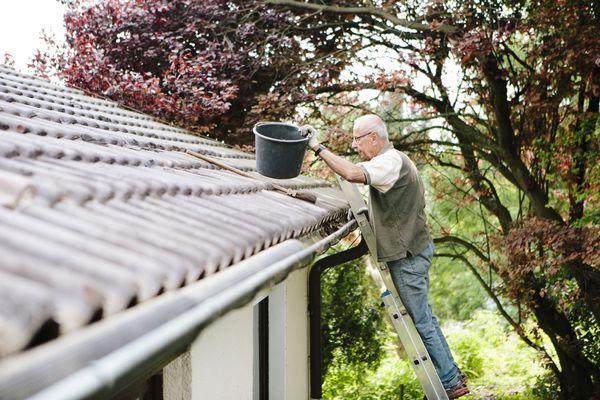 Man cleaning gutter