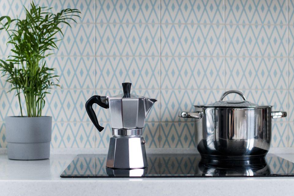 Silver moka pot on kitchen stove