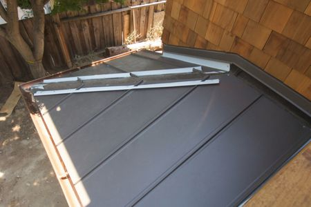 standing seam steel roof being installed 1500 x 1000 - How To Install A Metal Roof