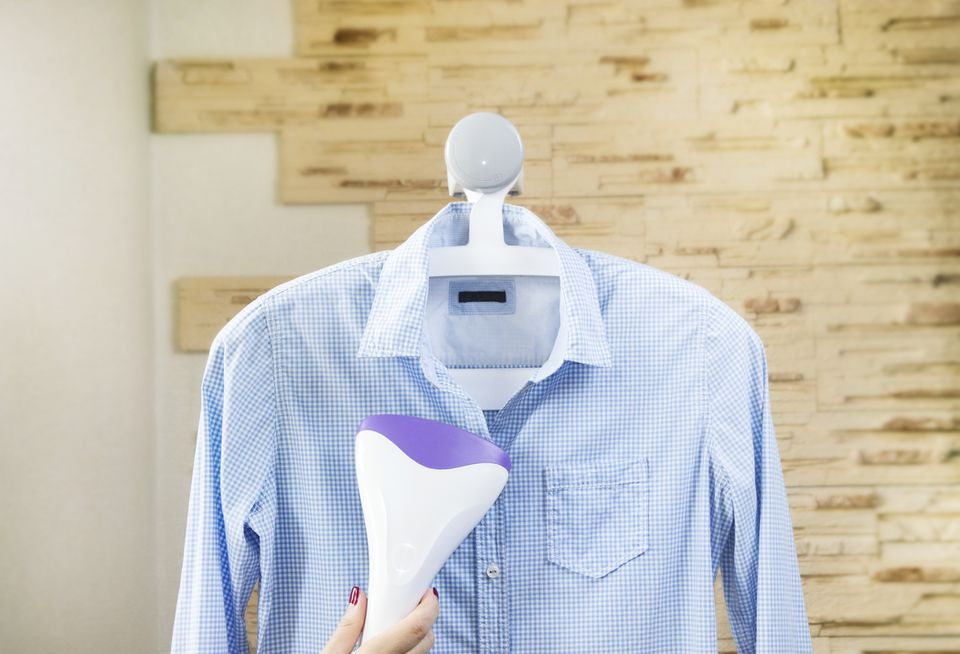 Hand steaming a dress shirt